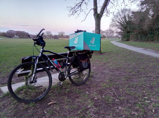 Landscape and bike with bricks in panniers a